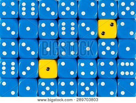 Pattern Background Of Random Ordered Blue Dices With Two Yellow Cubes