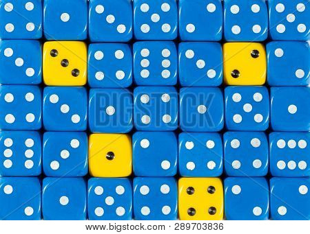 Pattern Background Of Random Ordered Blue Dices With Four Yellow Cubes