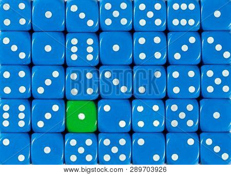 Pattern Background Of Random Ordered Blue Dices With One Green Cube