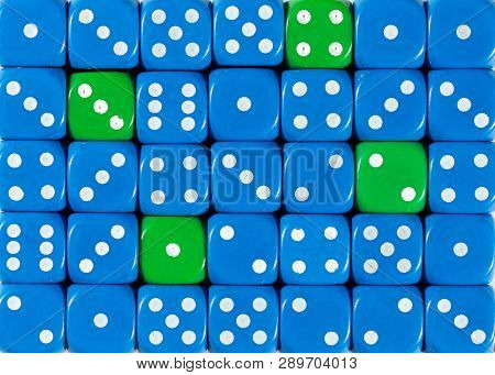 Pattern Background Of Random Ordered Blue Dices With Four Green Cubes