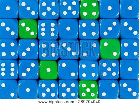 Pattern Background Of Random Ordered Blue Dices With Five Green Cubes