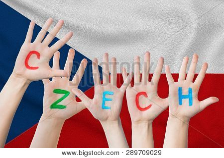 Czech Inscription On The Children's Hands Against The Background Of A Waving Flag Of The Czech Repub