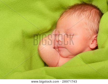 Sleeping Newborn Baby Boy in a Green Blanket