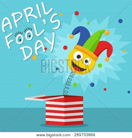 First April Fool Day Happy Holiday Greeting Card. Jack In The Box Toy On Blue Background. Jester Hat