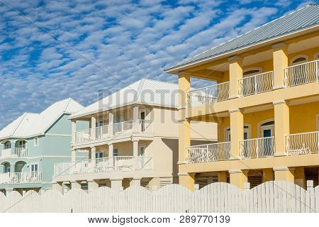 Brand New Oceanfront Multicolored Vacation Homes On The White Sandy Beach Of Gulf Of Mexico, Alabama