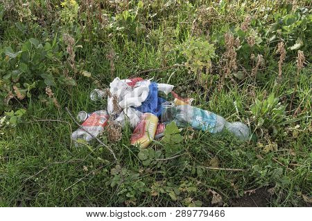 Sint Gillis Waas, Belgium - March 05, 2019, Cans, Plastic Bottles And Plastic Bags Dumped Into The N