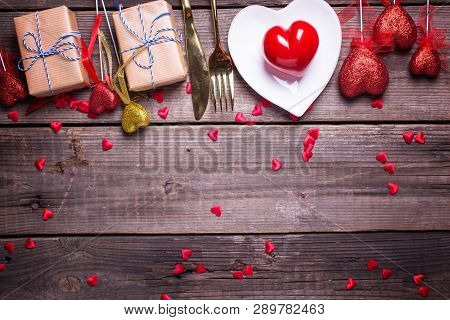 Border From Red And Gold Decorative Hearts, Boxes With Presents And Plate, Cultery On Vintage Wooden