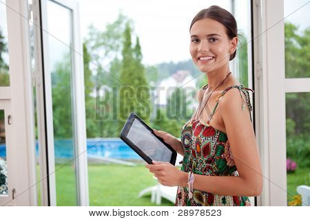 Attractive young woman holding tablet pc