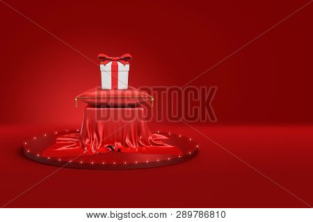 3d Rendering Of White Gift Box With Red Ribbon On Red Cushion And Pedestal Covered With Red Cloth On
