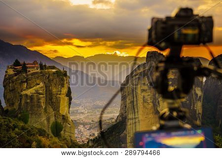 Professional Camera On Tripod Taking Picture Film Video From The Holy Trinity Monastery On Cliff At