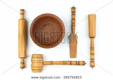 Set Of The Wooden Kitchen Utensils On White Background. Top View.