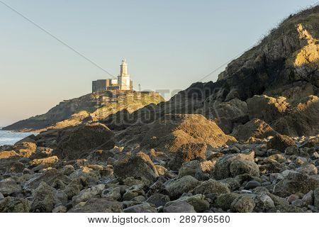 Mumbles Lighthouse Landscape At Dusk, South Wales