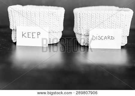 Storage Baskets To Divide Items To Keep From Those To Declutter Or Donate