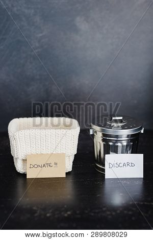 Storage Basket And Gargabe Bin To Select Which Items To Keep And Which To Discard, Declutter Concept