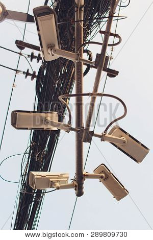 Security Cctv Camera Is Installed In Three Directions At Post With Many Cables.clutter Of Wires.non-