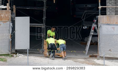 Gosford, New South Wales, Australia - January 31, 2019: Construction Workers Receiving Goods Deliver