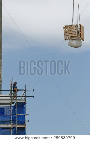 Gosford, New South Wales, Australia - January 31, 2019:  A Working Tower Crane Operation Close Up On