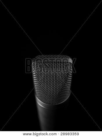 Isolated Microphone Over Black Background