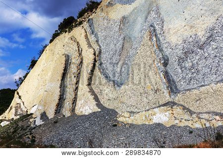 Shale Mountains Cement Pits. The Texture Of The Stone Wall. Large Stone Cracks, The Separation Of Th