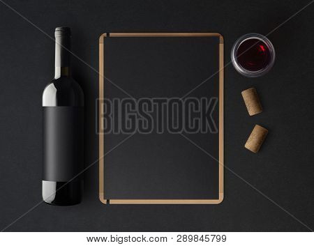 Bottle Of Red Wine With A Black Label On A Dark Background, A Wine Menu Template And A Glass Of Wine