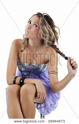 girl sitting with funny expression, pulling hair.