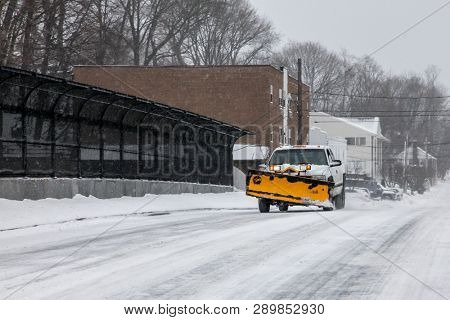 NORWALK,CT - JANUARY 27, 2015:  Car with snow plow  on Taylor Ave after winter storm.