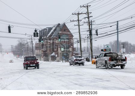 NORWALK,CT - JANUARY 27, 2015:  Cars on Connecticut Ave (RD-1) after winter storm.