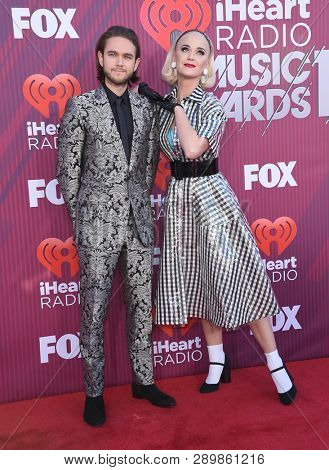 LOS ANGELES - MAR 14:  Zedd and Katy Perry arrives for the iHeart Radio Music Awards 2019 on March 14, 2019 in Los Angeles, CA