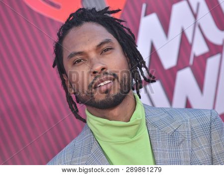 LOS ANGELES - MAR 14:  Miguel arrives for the iHeart Radio Music Awards 2019 on March 14, 2019 in Los Angeles, CA