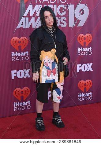 LOS ANGELES - MAR 14:  Billie Eilish arrives for the iHeart Radio Music Awards 2019 on March 14, 2019 in Los Angeles, CA