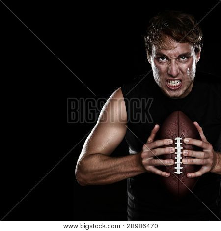 American football player staring aggressive holding american football on black background. Strong fit Caucasian fitness man with black copy space. poster