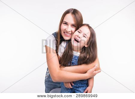 Family, Children And Parenthood Concept - Young Woman With Her Little Cute Child On White Background