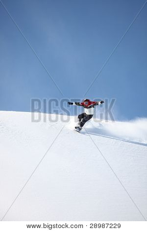Man snowboarding down hill