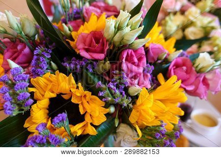 Bouquet Of Multicolored Flowers On A Dark Background. Colorful Bouquet Of Different Fresh Flowers. R
