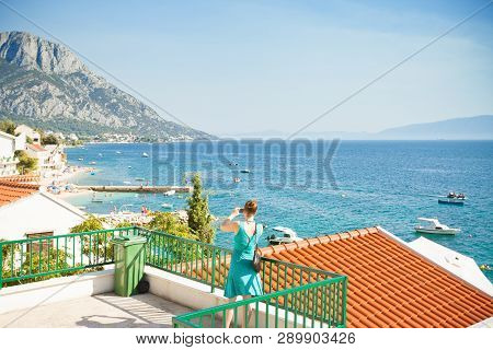 Brist, Dalmatia, Croatia, Europe - A Woman Taking A Picture Of The Beautiful Bay Of Brist