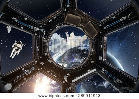 Cockpit view from International Space Station nearby of planet Earth. Concept of exploration and research, rocket launching. Some elements are composed by NASA images.