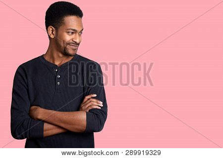 Portrait Of Confident Charismatic Young Handsome African American Male In Black Casual Shirt With Ha