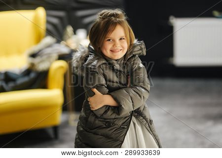 Little Girl In White Dress And Jaket At Studio. Happy Girl Smile