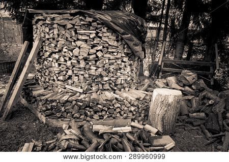 A Very Large Pile Of Chopped Wood In Black And White