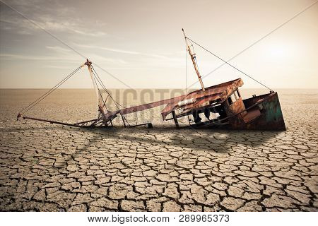 Rusty Ship In A Dried Ocean. Concept Of Global Warming And Climate Change