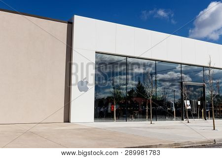 Indianapolis - Circa March 2019: Apple Store Retail Mall Location. Apple Sells And Services The Ipho