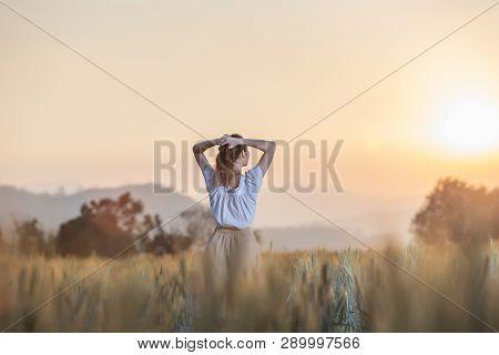 Beautiful Asian Woman Having Fun At Barley Field In Summer At Sunset Time