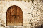 Old wooden door from medieval era. poster