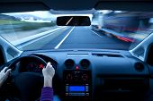 Blurred overtaking from inside vehicle, unrecognizable driver poster
