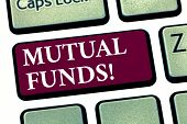 Conceptual hand writing showing Mutual Funds. Business photo showcasing Investment Strategy to purchase shares with other investors Keyboard key Intention to create computer message idea. poster