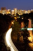 Highway 163 with colorful traffic flow toward San Diego downtown at night poster