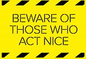 Beware of those who act nice Warning sign simple colours poster