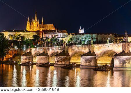 Prague Night Panorama. Prague Castle And Charles Bridge Above Vltava River, Praha, Czech Republic.