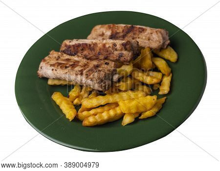 Grilled Pork Ribs With French Fries On Dark Green Plate. Pork Ribs With French Fries On A White Back