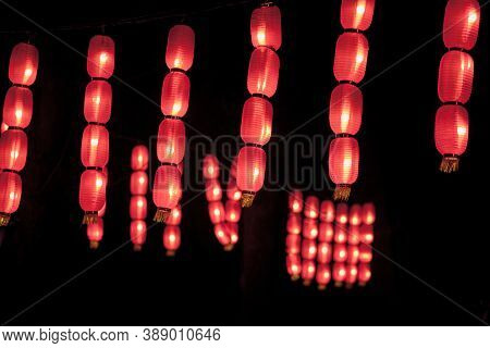 Red Chinese Paper Lanterns Lit In During A Dark Evening. Such Lanterns Are A Tradition In China And